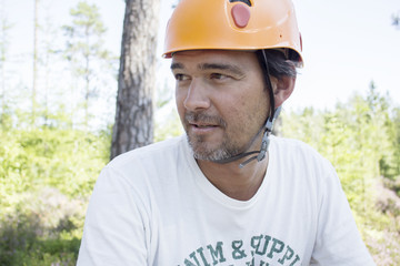 Mature man wearing helmet