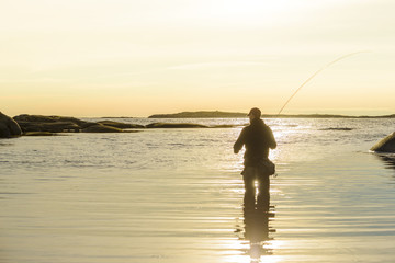 Silhouette of man fishing