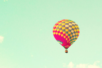 Vintage hot air balloons over mint sky