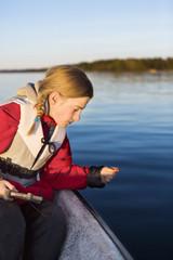 Teenage girl fishing on boat