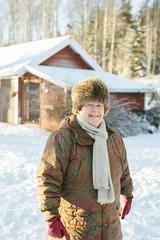 Smiling mature woman at winter