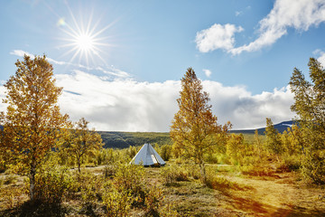 Scenic view of tent in landscape against cloudy sky