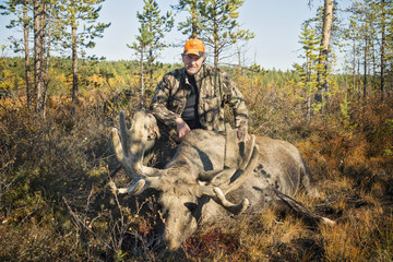 Hunter with dead elk