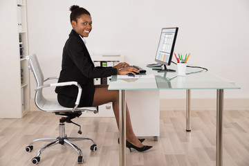 Happy Businesswoman Working In Office