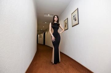 Beautiful brunette woman in long evening dress