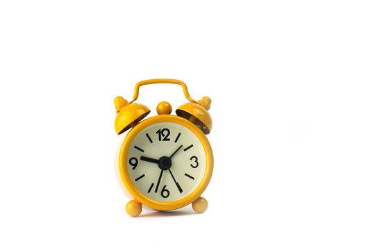 Yellow clock on white background.