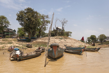Tree house of the Tonle sap lakeshore. Cambodia. Wood boat in the close up