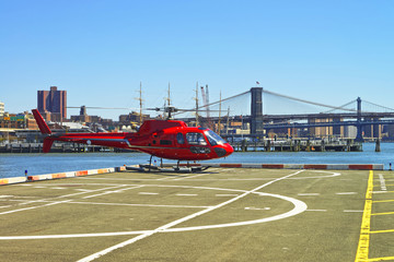 Helicopter taking off from helipad in Lower Manhattan New York