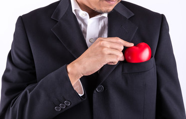man keeping red heart in suit pocket
