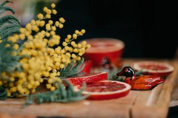 Red orange, mimosa and two souvenir duck Mandarin