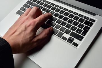 typing on laptop computer