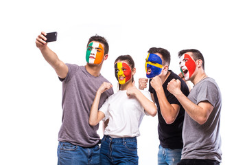Group of football fans support their national team: Belgium, Italy, Republic of Ireland, Sweden take selfie photo on white background. European football fans concept.