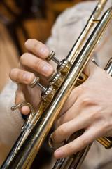 Hands closeup of a musician playing a trumpet