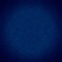 dark blue grainy background with circular vignette