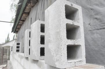 many neatly folded gray cinder blocks background closeup