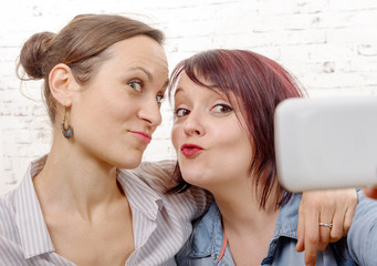 Two young women taking a selfie.