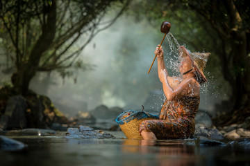 asian old woman take a bath in the river