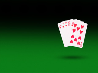 Straight Flush playing cards on the poker table