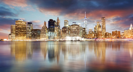 Wall Mural - New York city skyline at sunrise with reflection.
