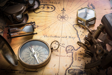 Fototapete - Old compass, sextant on vintage map. Retro style.