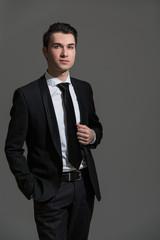 Businessman on grey background