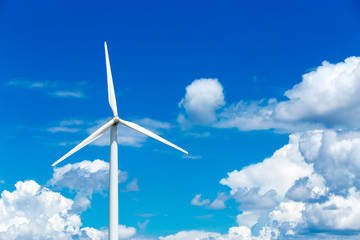 Wind turbine front view on blue sky