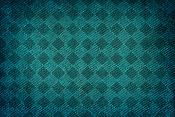 Turquoise fabric woven texture high contrasted with vignetting effect macro background rhombus styled