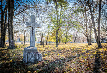 Old cross in the cemetery, perfect halloween background.