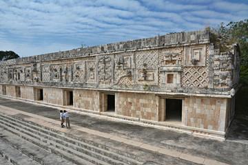 People viewing of the nunnery building in Uxmal. Yucatan Peninsu