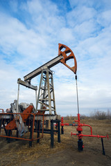 Pump-rocking chair at an oil field in the spring.