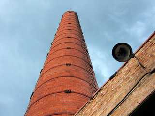 Industrial brick smoke stack with blue sky - landscape color photo