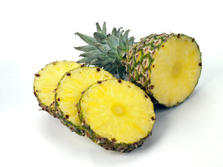 pineapple top and slices on white