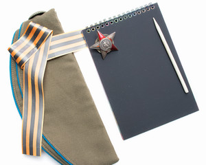 St. George ribbon, red star,notebook, field cap,