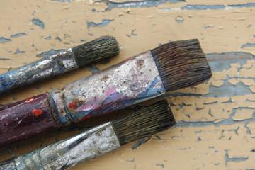 Paintbrush on grunge wood background