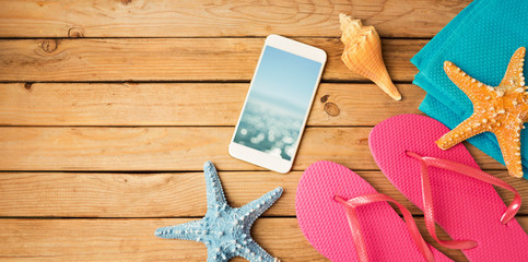 Smartphone mock up template with summer beach items. View from above. Flat lay