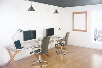 Office with blank screens