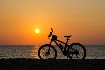Mountain bike on the beach and sunset