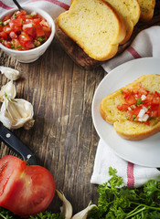 Garlic bread  topped with tomato, garlic and herbs