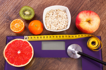 Electronic bathroom scale, centimeter and stethoscope, healthy food, slimming and healthy lifestyles concept