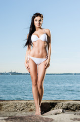 Beautiful and fit fashion model in a swimsuit