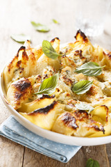 Pasta bake with cheese and herbs
