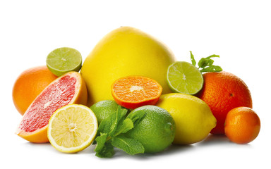 Mixed citrus fruit including lemons, limes, grapefruit, pomelo and tangerines with mint sprigs isolated on a white background, close up Fototapete