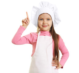 Beautiful little girl in chef uniform isolated on white