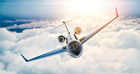 Image of black luxury generic design private jet flying in blue sky at sunset. Huge white clouds background. Business travel concept. Horizontal . 3d rendering