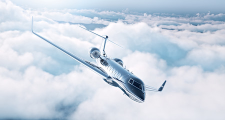 Picture of black luxury generic design private jet flying in blue sky. Huge white clouds at background. Business travel concept. Horizontal . 3d rendering