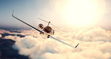 Image of black luxury generic design private jet flying in blue sky at sunset. Huge white clouds and sun background. Business travel concept. Horizontal , front view. 3d rendering