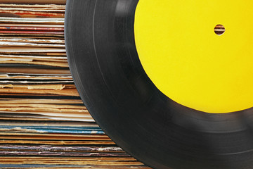 Old vinyl records with yellow label on paper background