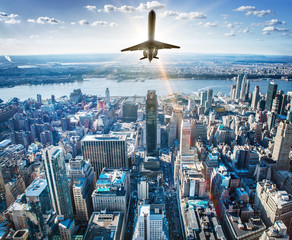 Wall Mural - airplane over a skyline