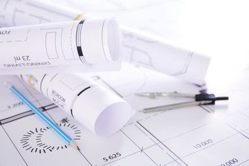 Set of construction blueprints with divider and pencil closeup