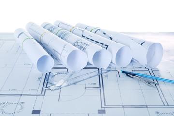 Set of construction blueprints with tools closeup